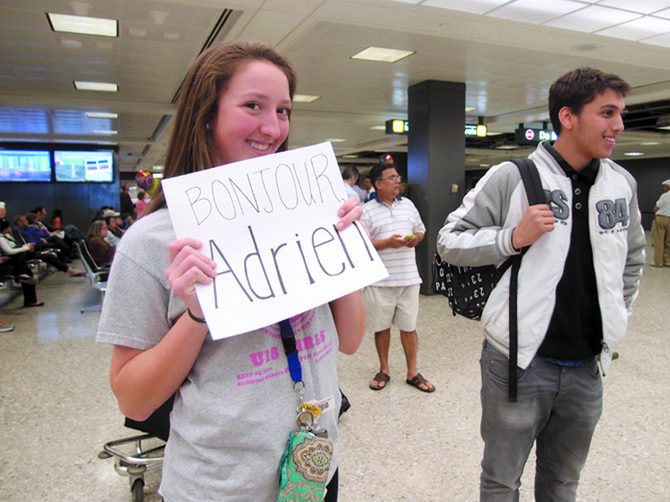 Savannah Willet, a tenth-grader at Robinson Secondary School, meets her French pen pal Adrien for the first time at Dulles on April 20.