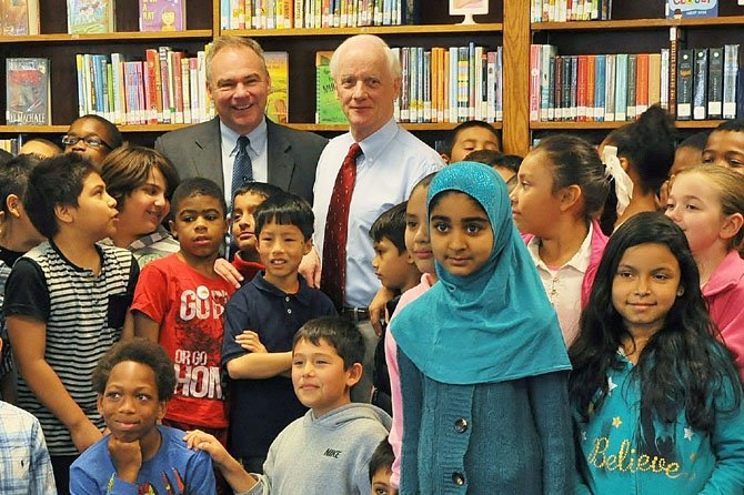 "U.S. Sen. Tim Kaine and former Oklahoma Gov. Frank Keating, president and CEO of the American Bankers Association with the fourth graders of Hollin Meadows Elementary School. They gave a financial literacy lesson for ""Teach Children To Save Day,"" sponsored by American Bankers Association."