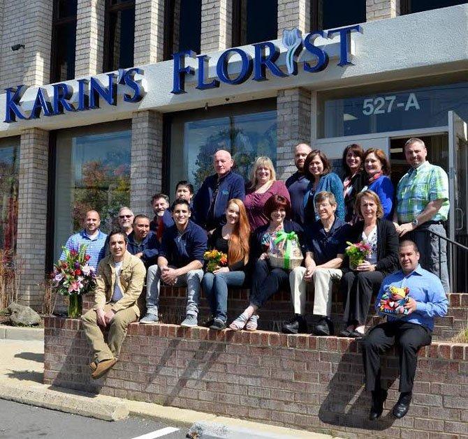 Maris Angolia (top row, fourth from right), gathered her team of award-winning designers and employees for a photo celebrating Karin's Florist 58 years in business. The Fairfax Chamber awarded the family-owned business its 2012 Outstanding Corporate Citizenship Award for small business.