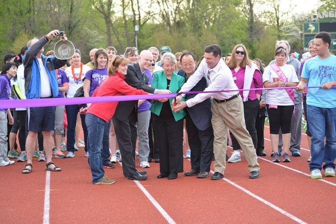 From left, McLean HS Principal Ellen Reilly, FCPS Board At Large Member Ryan McElveen, FCPS Board Dranesville District Member Jane Strauss, FCPS Board Chairman Ilryong Moon and Langley HS Principal Matt Ragone get things started cutting the ribbon on the 2014 Relay for Life event at Langley High School.