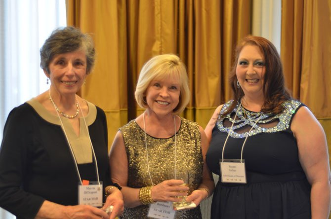 Herndon-Reston FISH volunteers Marcia Di Trapani and JoAnn Bordeaux were recognized for their work with FISH at the Annual Fish Fling held at Crowne Plaza Dulles Airport Hotel on Saturday, April 26. With them is Susan Sather, a FISH community board member.