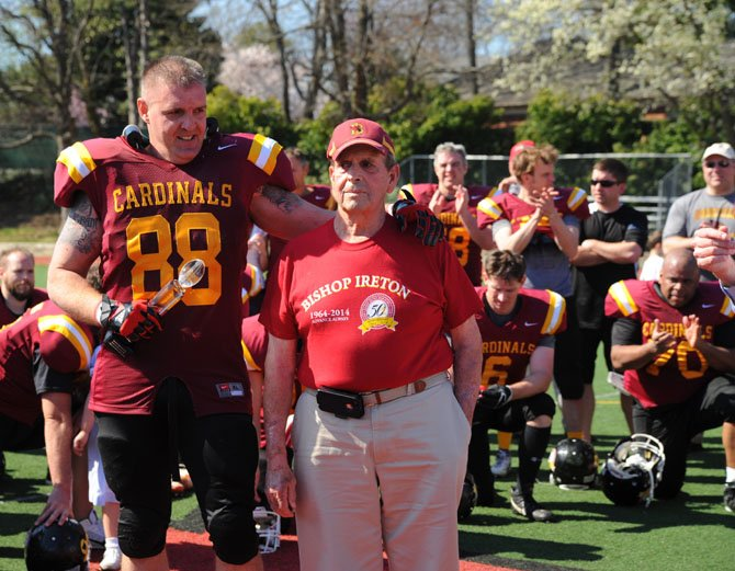 Charles O'Malley, right, stands along the sidelines of Fannon Field with Derek Radoski (BI '89) at the April 12 Bishop Ireton alumni football game to raise money for the Sean O'Malley scholarship fund.