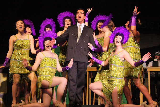 "Cameron Powell (Leo), surrounded by showgirls, sings ""I Want to be a Producer."""
