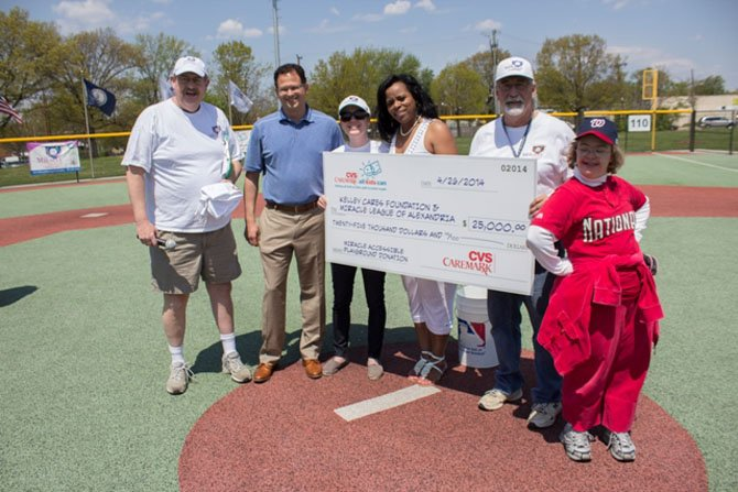 From left: Bill Rivers, Miracle League chair; Keith Reynolds, CVS Caremark vice president of sales and account services; Lindsey Swanson, executive director of the Kelley Cares Foundation; Jackie Person, therapeutic recreation program manager for the City of Alexandria; Mac Slover, director of Ssports for the City of Alexandria, and Ellen, Miracle League participant.