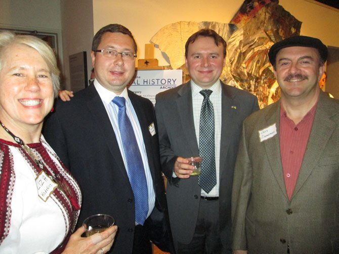 Enjoying the festivities in commemoration of the Arlington Sister City Association's 20th anniversary and the launch of a new oral history project are, from left, Liza Hodskin, aid to the chair of the Arlington County Board; Counselor Stanislav Yezhov from the Embassy of Ukraine; Andrew Tsintsiruk, a representative of Arlington Sister City Association's partnership with Ivano-Frankivsk, Ukraine, and former County Board member Chris Zimmerman.