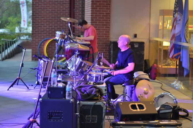 Musicians Paul Voshell on the drums and David James handled percussions at the May 2 Friday Night Live Concert at the Town of Herndon.