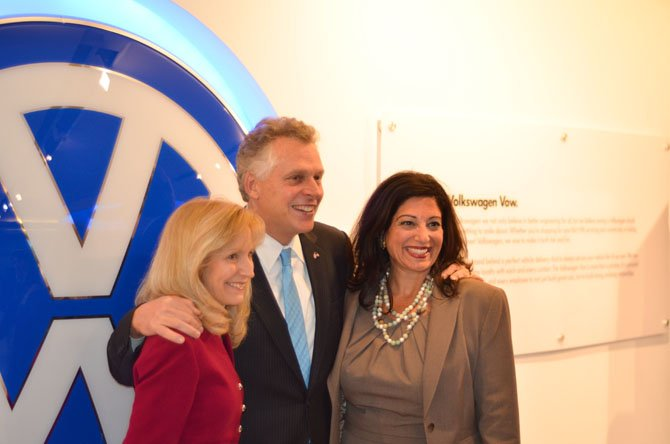 Volkswagen Group of America Vice President of Industry-Government Relations Anna-Maria Schneider smiles for a photo with Governor Terry McAuliffe and Volkswagen Group of America Director Nicole Barranco at headquarters in Herndon.