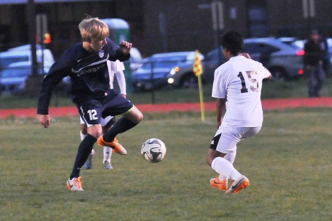 Washington-Lee junior Jacob Campbell, left, and the Generals remained undefeated with a 2-0 victory against Mount Vernon on Monday.