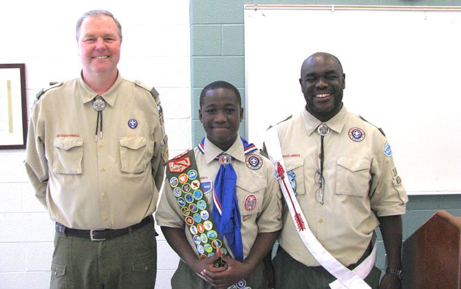 Scoutmaster Kevin Gaughan (left), Boy Scout Chiti Tembo and his father Assistant Scoutmaster Mulenga Tembo.