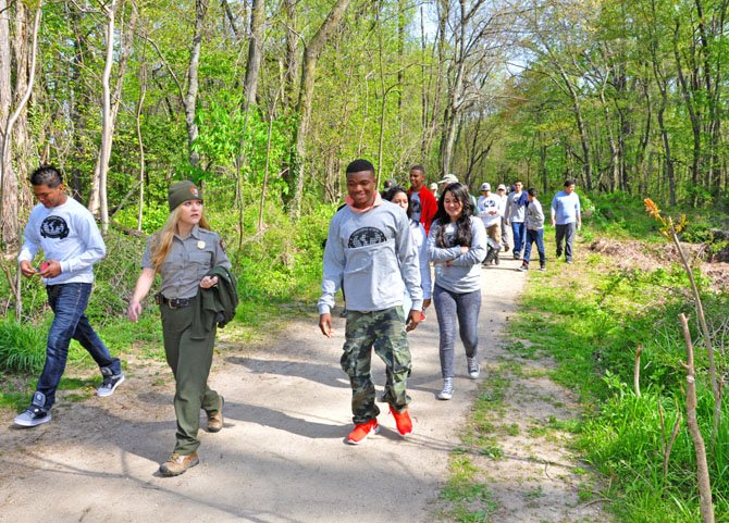 Sarah Gamble, a park ranger with the National Park Service, walked T.C. Williams International Academy students to the focus areas in Dyke Marsh.