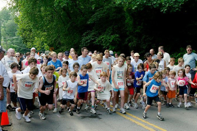 Participants of last year's Clifton Caboose Twilight Run get ready for the one-mile fun run. This year's event is May 17 at 6 p.m.
