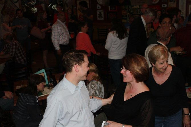 Lisa Merkel chats excitably at Jimmy's Old Town Tavern after finding out she won the Herndon Town election for mayor.