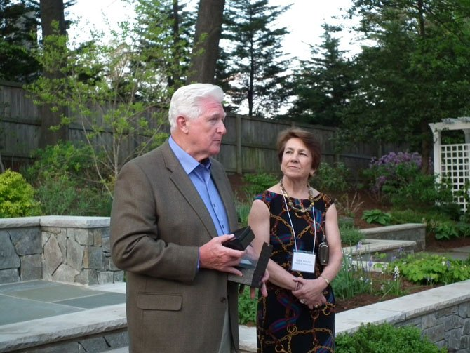Child & Family Network Centers board member Kate Boyce presents an award to U.S. Rep. Jim Moran for his commitment to universal early education.