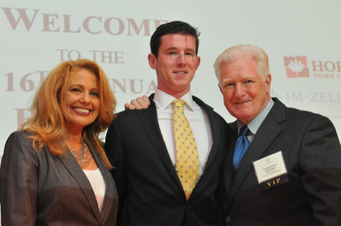 Summit emcee Rebecca Cooper of ABC7/WJLA-TV and U.S. Rep. Jim Moran congratulate 2014 Veteran of the Year Brendan O'Toole.