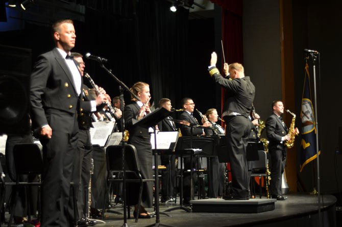 The U.S. Navy Concert Band conducted by Captain Brian O. Walden played at Herndon High School on May 9. At the end of the concert, the U.S. Navy band played songs associated with the uniformed services of the United States.