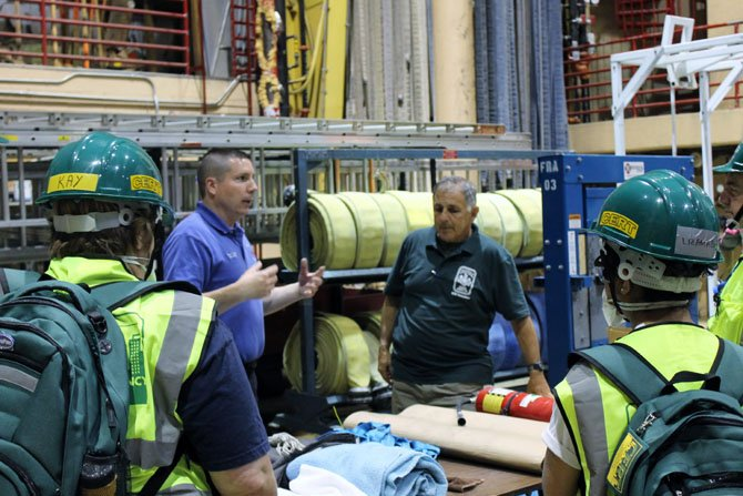 CERT teachers include members of the Fairfax County Fire and Rescue who are experienced in emergency response. Here, instructors guide a group of students at a CERT class on May 12.