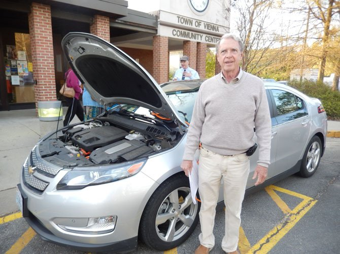 Dennis Dineen with his electric-hybrid Chevy Volt.