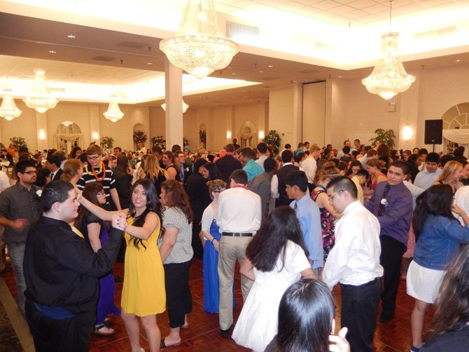 Under crystal chandeliers, students have fun on the Waterford dance floor.