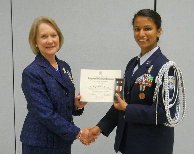 Marsha Price, of Providence Chapter, Daughters of the American Revolution, with Tanya Kumar.
