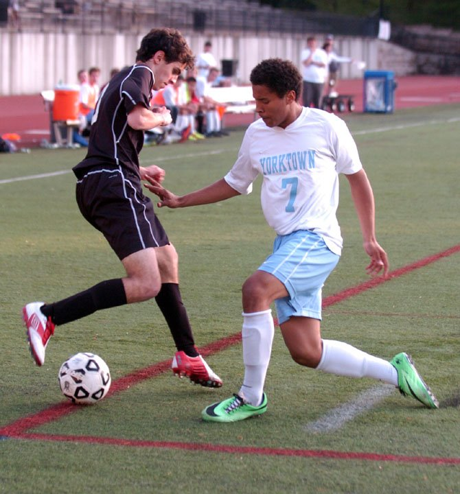 Yorktown forward Michael Monahan, right, scored the game-winning goal in sudden-death overtime against Madison during the Conference 6 tournament quarterfinals on May 16.