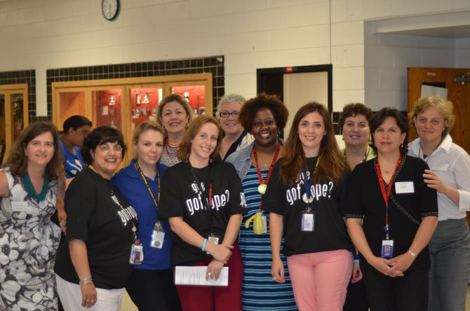 Individuals who organized the Herndon High presentation on Human Trafficking assemble for a photo. In the center is social worker Heather Coleman.
