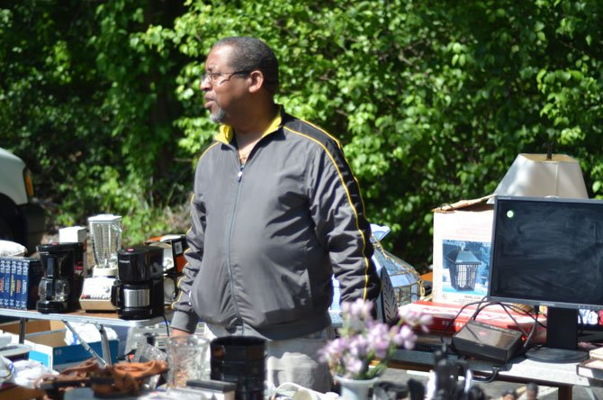Alexandria resident Alfred Carter by his vending station at the Reston biannual yard sale hosted by the Reston Association. Carter was one of 95 participants in the May biannual yard sale.