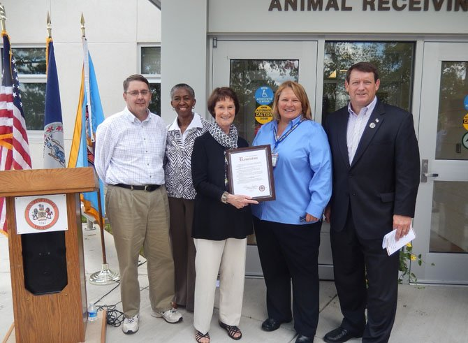 The Fairfax County Board of Supervisors presents a resolution to Animal Shelter Director Tawny Hammond. (From left) are Supervisors Michael Frey (R-Sully), Cathy Hudgins (D-Hunter Mill), Board Chairman Sharon Bulova, Hammond and Pat Herrity (R-Springfield).