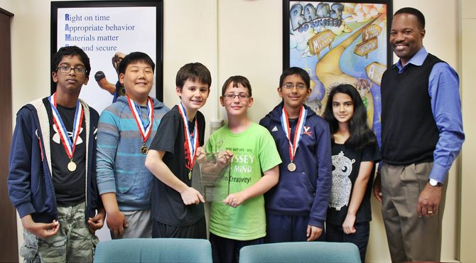 After taking winning the regional and state competition, Rocky Run Middle School will compete at the Odyssey of the Mind World competition at Iowa State University later this month. From left are Bharath Mathivanan, Daniel Hwang, Matthew Lichtblau, Maxwell Tabarrok, Rahil Shah and Shree Trivedi. With the team is Principal Anthony Terrell.