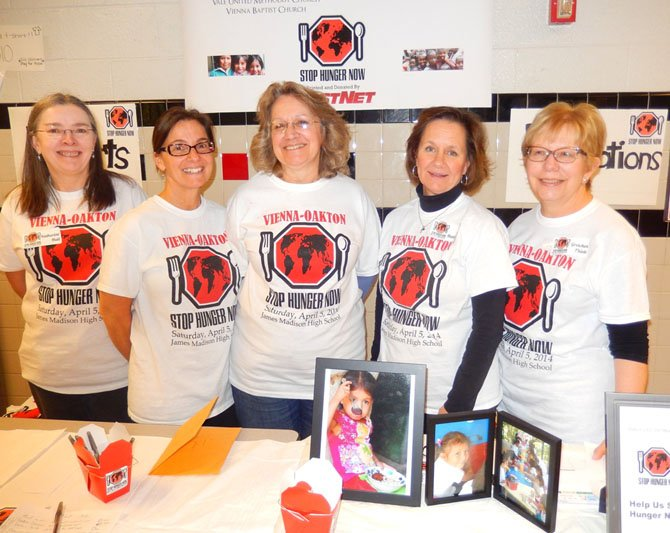 (From left) Katherine Hall, Julie Moore, Molly Quackenbush and Sue Hamblen, all of Vienna Presbyterian Church, and Gretchen Thiele of Emmanuel Lutheran Church, man the donation table.