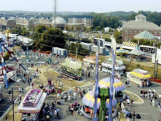The parking lot between Center Street and Station Street has historically been the site of carnival rides and games during the Herndon Festival.