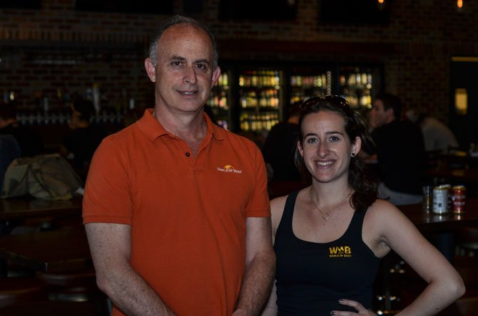 World of Beer Restaurant owner Evan Metz and Director of Operations Heather Matz smile for a photo at the Reston WOB location.
