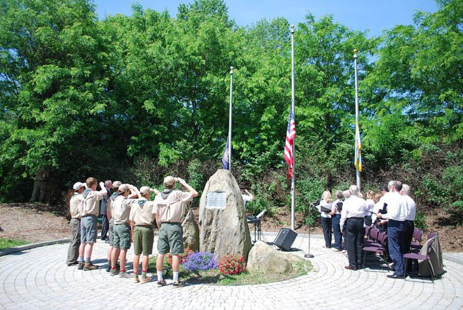 Boy Scout Troop 55 and the Great Falls United Methodist Church choir stand to say the Pledge of Allegiance at the Great Falls Freedom Memorial Monday, May 26.
