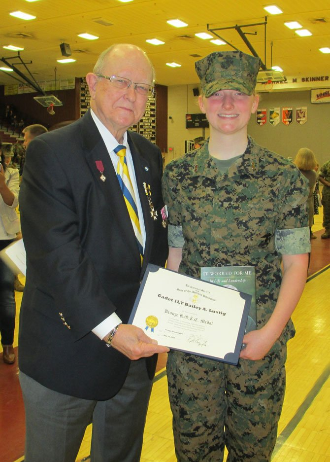 """Cadet 1LT Bailey Lustig, right, of Mount Vernon High School, receives a Bronze ROTC medal May 8 from Jack Pitzer of the George Washington Chapter of the Sons of the American Revolution. According to Pitzer, the award is given """"in recognition of outstanding leadership qualities, military bearing and excellence, exemplifying the high ideals and principles which motivated and sustained our patriot ancestors."""""""