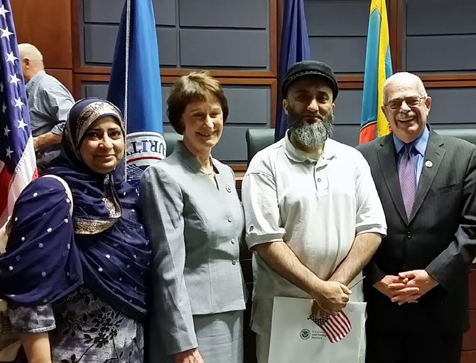 Jaheda Guliwala, Board of Supervisors Chairman Sharon Bulova, Hanif Guliwala, and U.S. Rep. Gerry Connolly (D-11) celebrate Hanif's new American citizenship after a naturalization ceremony at the Fairfax County Government Center on May 23.