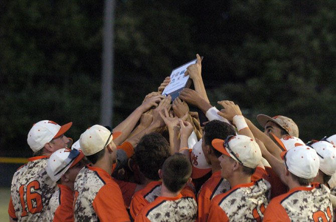 The West Springfield baseball team celebrates winning the Conference 7 tournament on May 23.