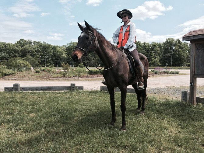 Faith Campbell on her horse, Tiger, who is a 31-year-old thoroughbred, pictured at Meadowood Special Recreation Management Area in Lorton. Campbell has owned Tiger for 24 years, and is a volunteer with the Bureau of Land Management at Meadowood.