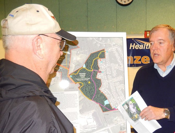 Sully District Planning Commissioner John Litzenberger (on right) discusses the Hickory Forest Park with a resident.