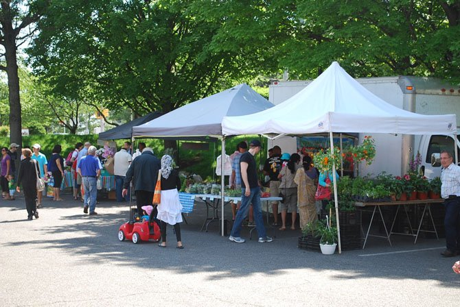 Community members shop at the grand opening of the Tysons Smart Markets Farmers' Market Sunday, June 1.