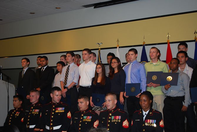 The Marine Corps enlistees of Fairfax, Loudon and Prince William counties stand with their recruitment officers at the fourth annual Our Community Salutes Enlistee Recognition Ceremony Thursday, May 29.