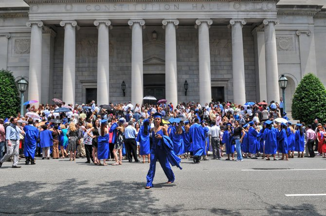 Family, friends and graduates of Thomas S. Wootton High School's Class of 2014 gather outside of Constitution Hall before the commencement ceremony on Wednesday, May 28.