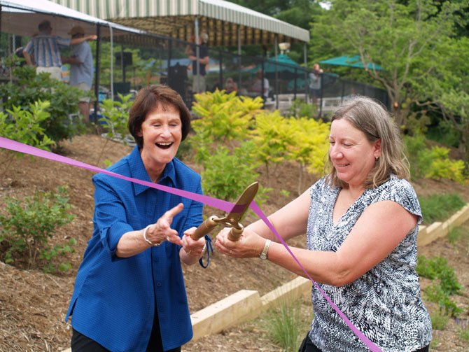 Sharon Bulova, Chairman of the Fairfax County Board of Supervisors, with Cheryl McDonald, the 2014 Braddock District Volunteer Fairfax Community Champion, at the ribbon cutting ceremony of the Danbury Forest Centerpiece Garden.