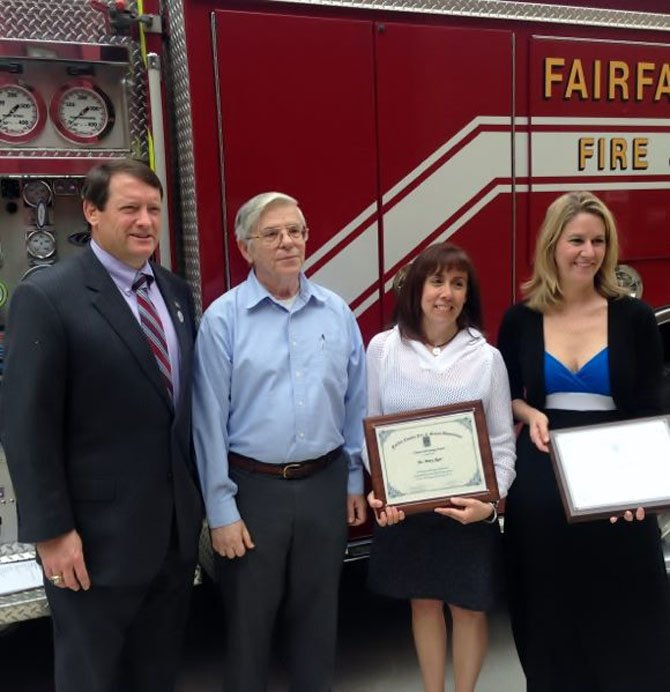 Supervisor Pat Herrity and Michael Martinka stand with Mary Ager and Dayna Cooper, who recently received Citizen Recognition-Lifesaving Awards for performing CPR on Martinka and saving his life.