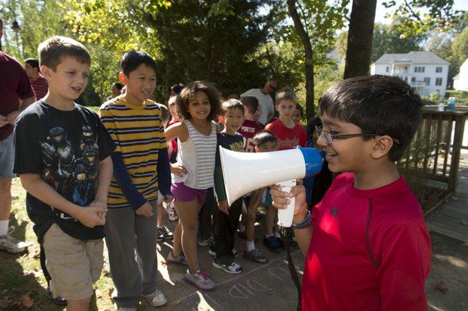 Rohil Bhinge rallies his friends through a megaphone prior to his first Fun Run event.