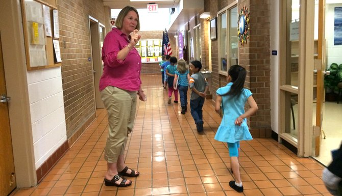 Hybla Valley Elementary School Principal Lauren Sheehy greets students in the hallway.