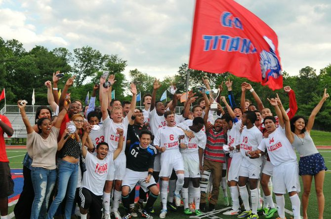 The T.C. Williams boys' soccer team celebrates winning the 6A North region championship on Thursday.