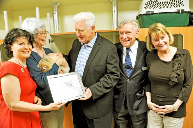 A framed photo of Arrow was presented to Arrow's adopter, Anne Hancock (holding Arrow) along with supporters state Sen. Barbara Favola, U.S. Rep. Jim Moran (D-8), President/CEO of AWLA Neil Trent and Patricia Ragan, AWLA board president.