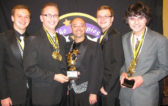 "The award for Best Musical went to the team of ""Spamalot"" from West Potomac High School. From left: Hunter Harlow, Peter Serle, Director Peele Clark, Austin Harlow and Eddie Perez."