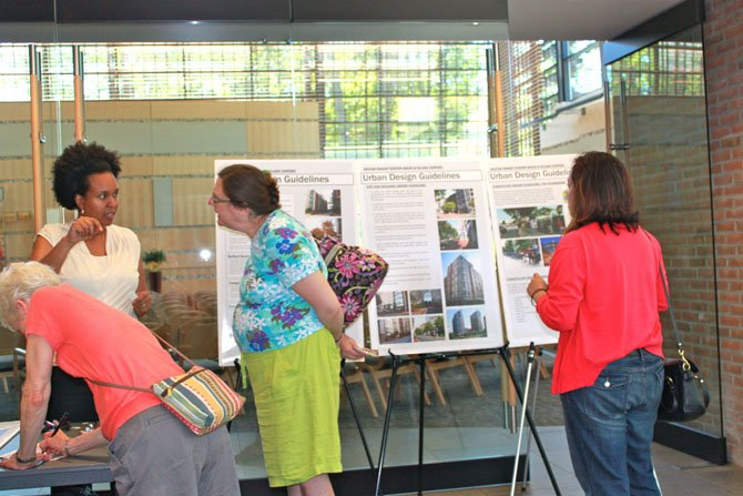 Residents look at urban design guidelines during Reston Phase II open house Saturday at United Christian Parish.
