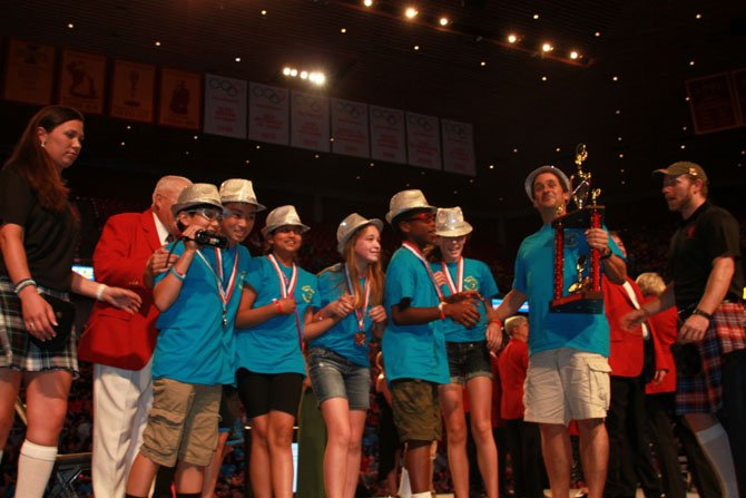 Seventh grade Nysmith Odyssey of the Mind team won the third place trophy in the World Finals in Ames, Iowa.