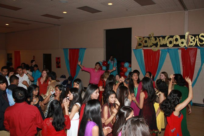 Students dance Bhangra during Bollywood Bash on Saturday.